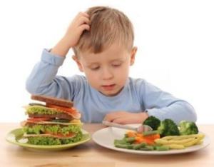 child_boy eating veg_cropped