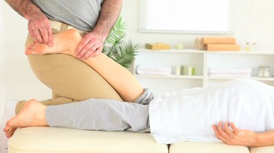 stock-footage-chiropractor-massaging-a-cute-woman-s-foot-in-a-room