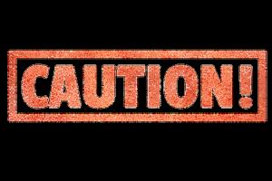 caution sign, sitting